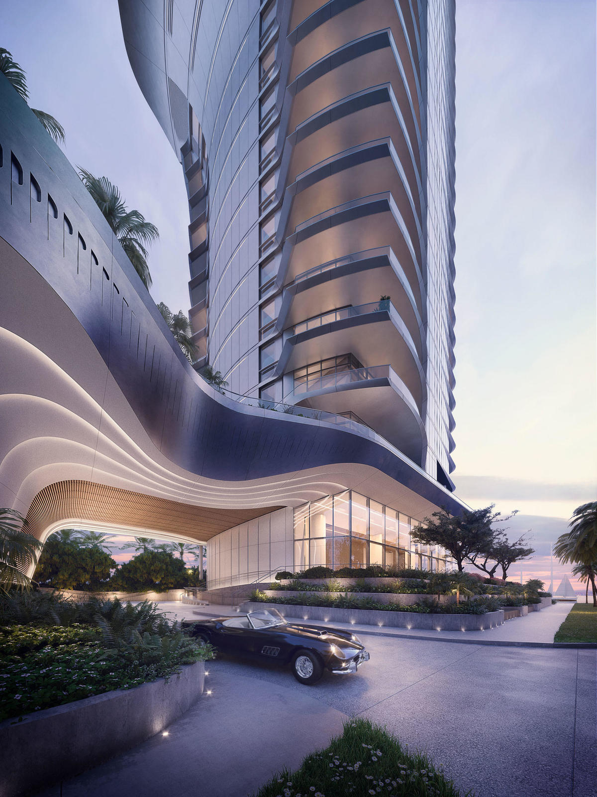 The dramatic entryway at Una's new waterfront Miami condominium is marked by a curvilinear double-height porte cochère.