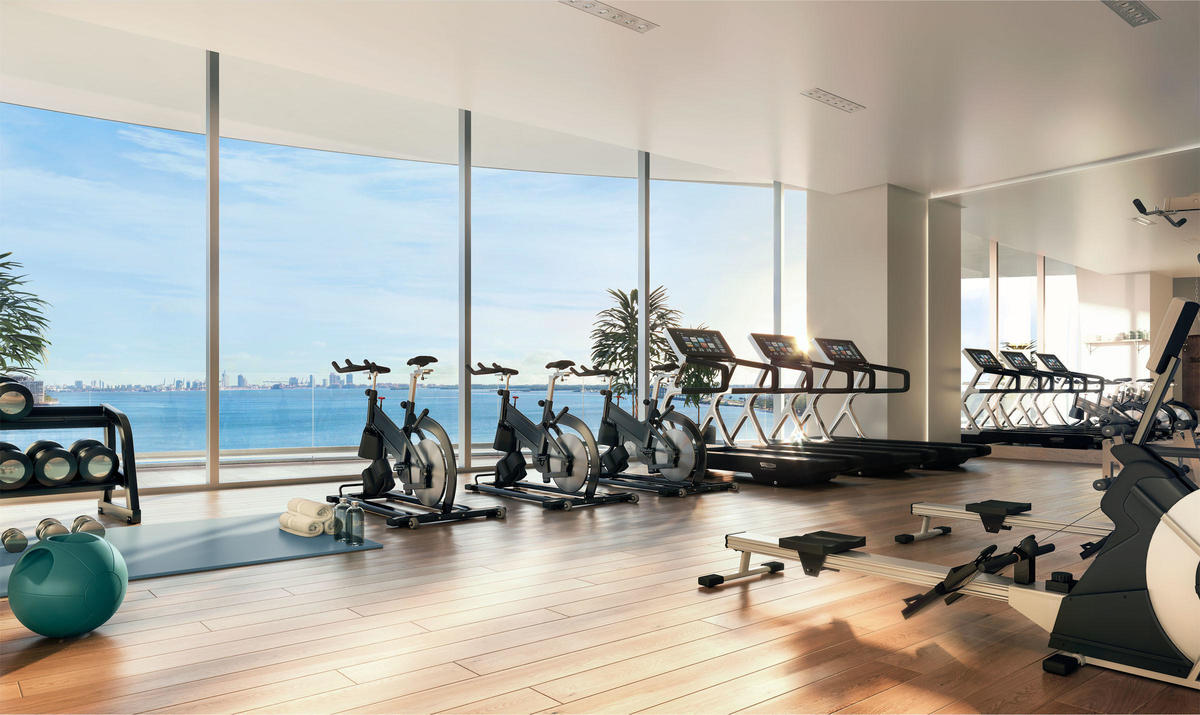 The design of the condo's gym maximizes light and space.